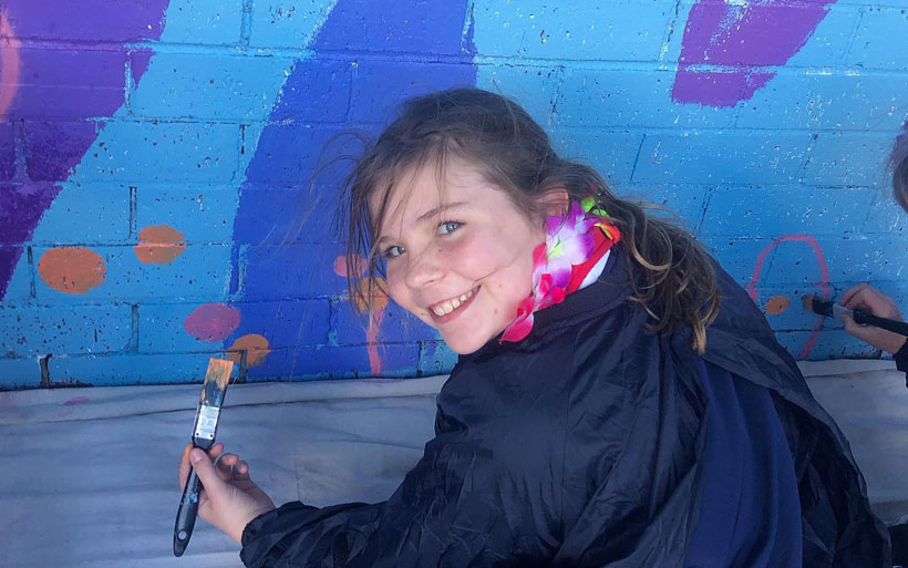 Happy student training to be a mural painter