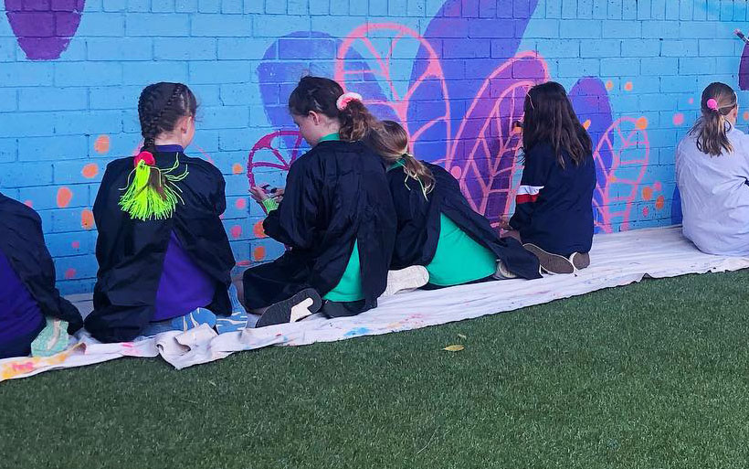 Sydney school students painting a mural